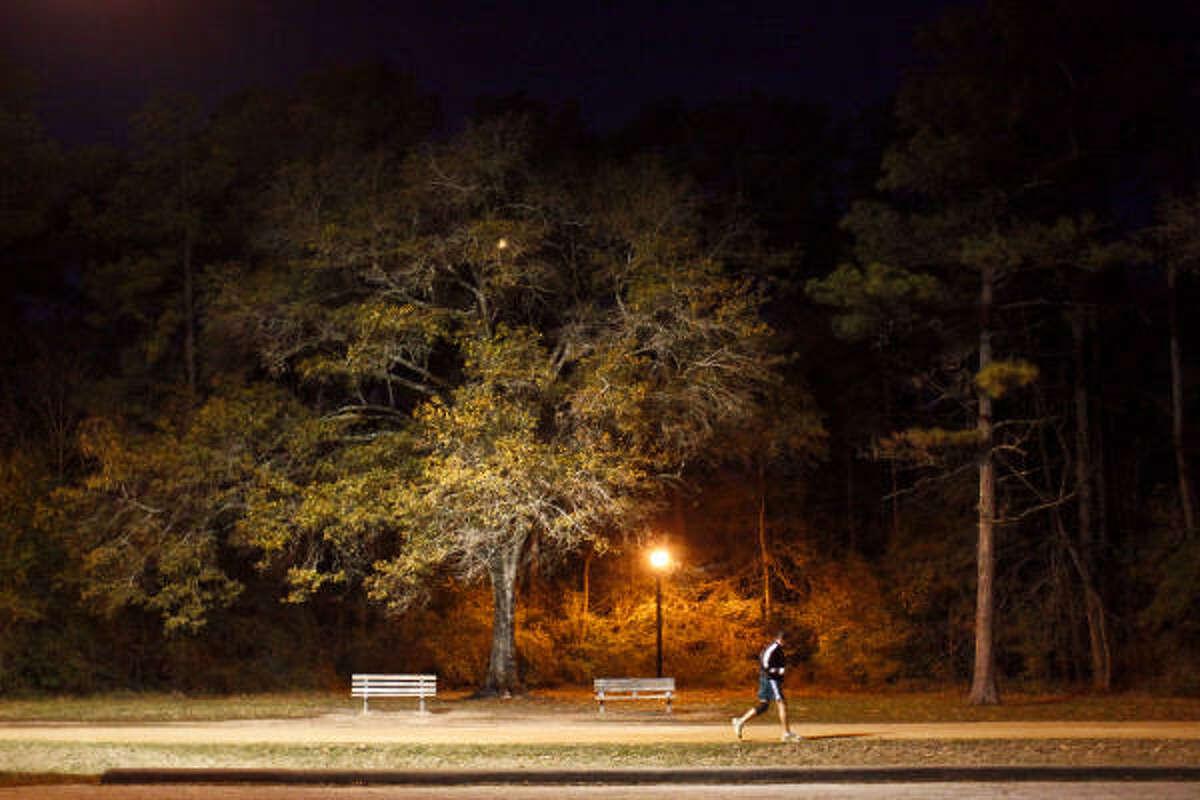 A member of the Kenyan Way running team strides around Memorial Park during the team's final Marathon prep run.