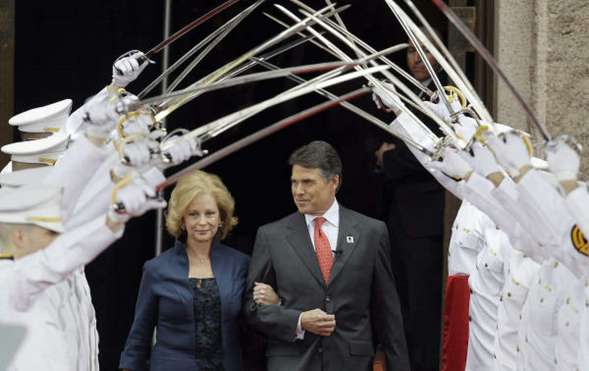 Gov. Rick Perry, right, and his wife, Anita, arrive for his inauguration in Austin, Texas.