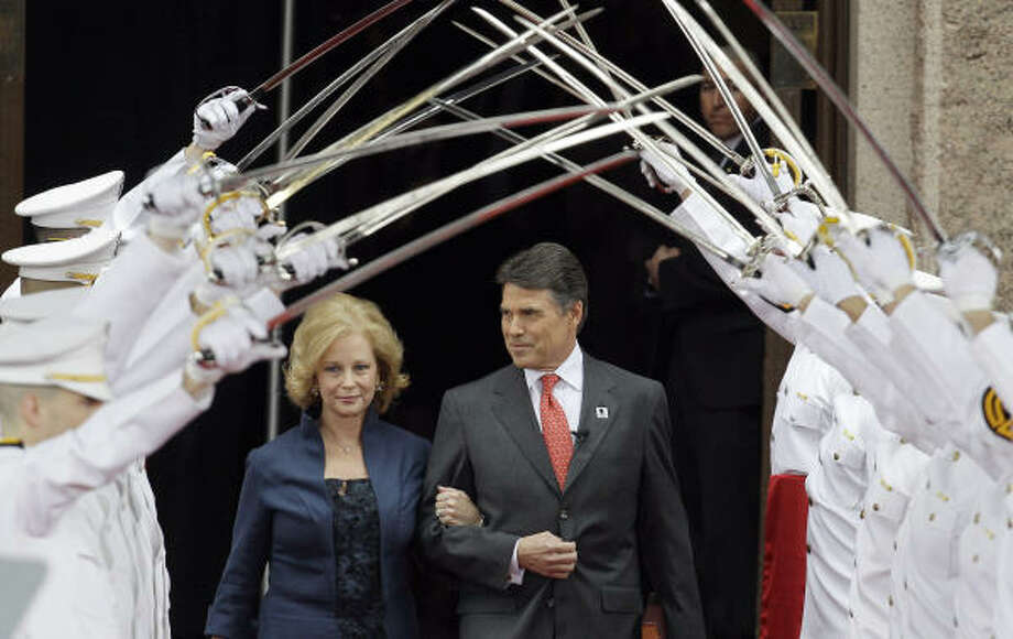 Gov. Rick Perry, right, and his wife, Anita, arrive for his inauguration in Austin, Texas. Photo: Eric Gay, AP