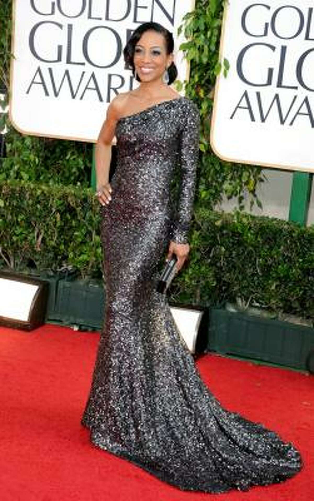 Access Hollywood's Shaun Robinson looked stunning in her charcoal, one shoulder sparkling gown.
