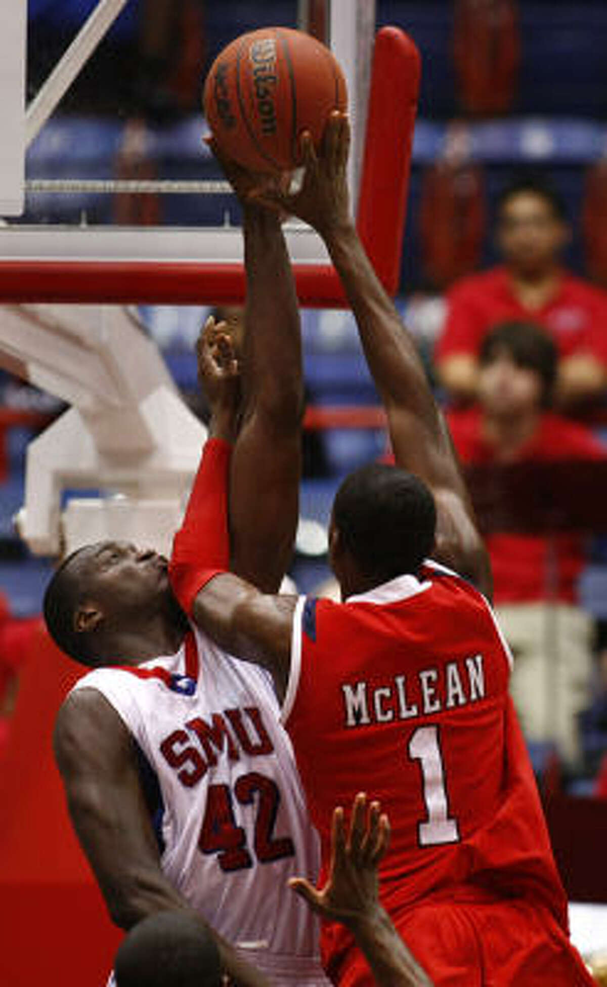 SMU forward Papa Dia (42) records one of his seven blocks on this shot by UH forward Mikhail McLean.
