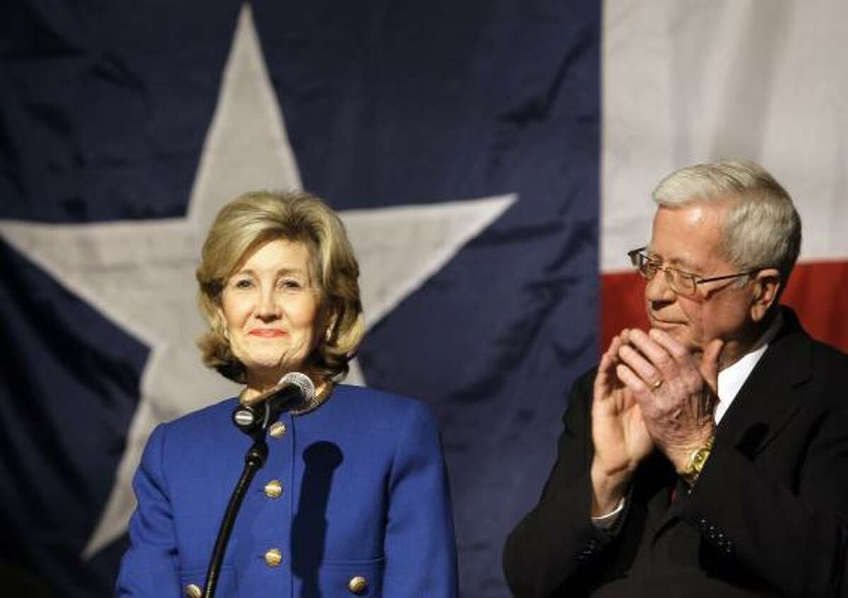 Sen. Kay Bailey Hutchison, R-Texas, left, smiles as she acknowledges support from her husband Ray, right, and others following her speech conceding from the Republican nomination for Texas governor in Dallas on Tuesday, March 2, 2010.