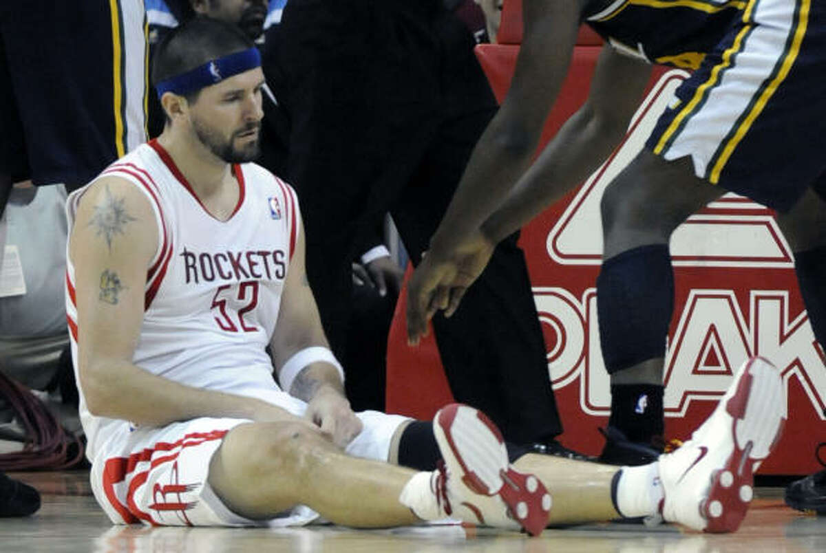 Rockets center Brad Miller sits on the court after committing a foul during the fourth quarter.