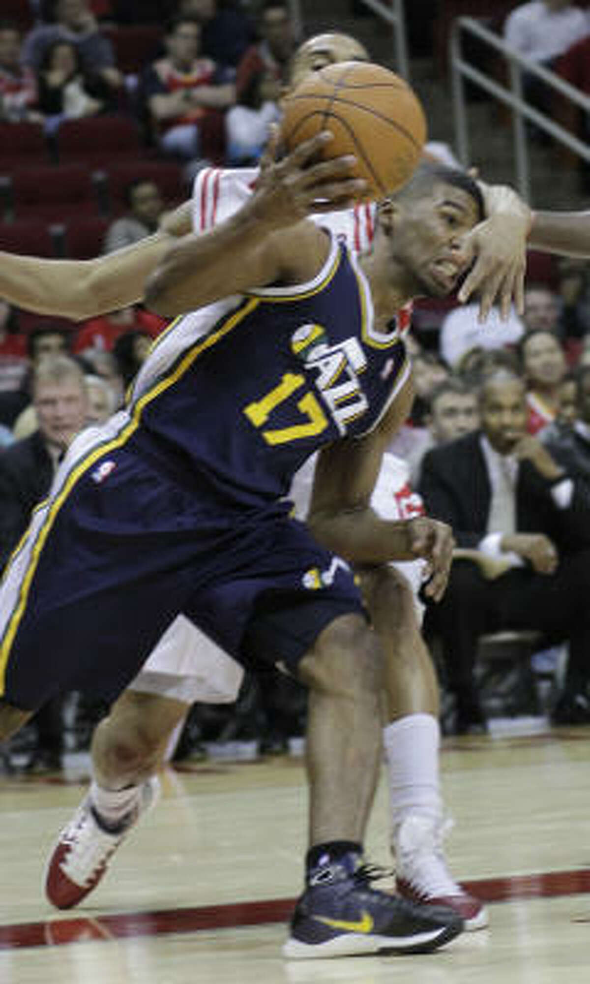 Jazz guard Ronnie Price (17) is fouled by Rockets guard Ishmael Smith.