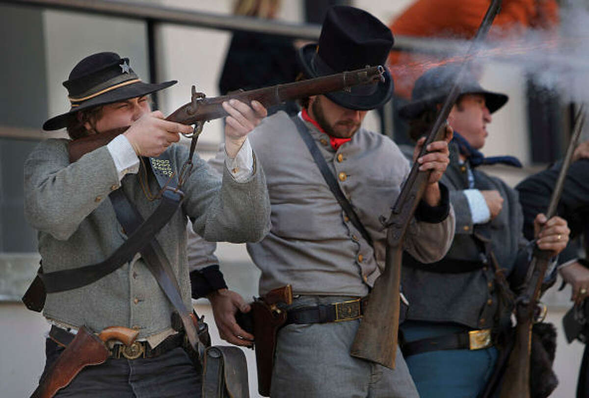 Travis Ramsey fires at Union Soldier during the re-enactment of the 1863 Battle of Galveston on the Strands.