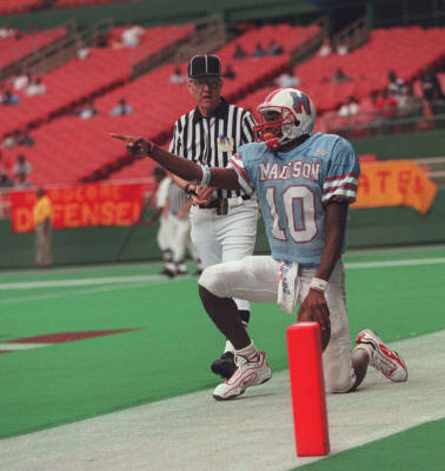 2000Vince Young always has seemed at home on the field, whether during his days at Madison or slapping hands with fans after a summer scrimmage in Austin. Here he celebrates in the end zone after scoring a touchdown against Yates at the Astrodome. Photo: James Nielsen, Chronicle