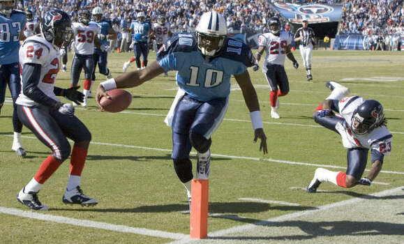 2006 In his first game against his hometown team, Vince Young led the Titans to a 28-22 victory. He threw for a touchdown and also scored on a 20-yard run, splitting Texans safety C.C. Brown, left, and Dunta Robinson to get into the end zone. Photo: BRETT COOMER, CHRONICLE