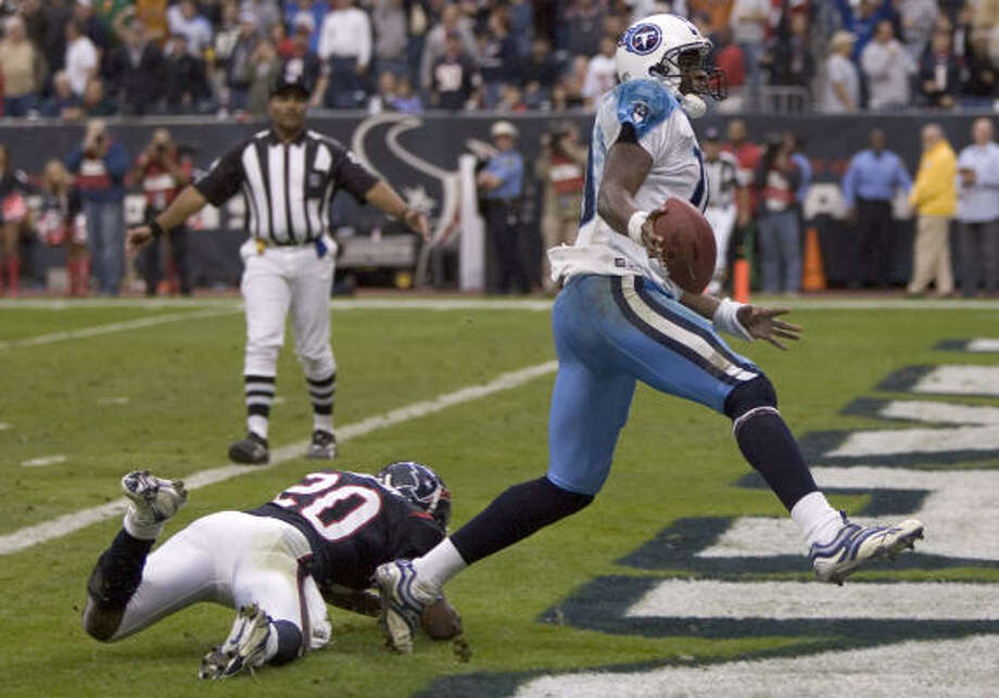 2006In his second showdown with the Texans, Vince Young ran for a 39-yard touchdown in overtime to give the Titans a 26-20 victory at Reliant Stadium. Photo: BRETT COOMER, CHRONICLE