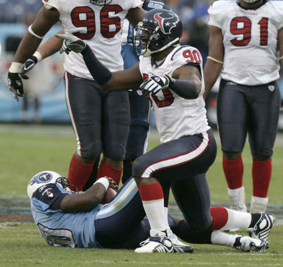 2007Vince Young was sacked 2½ times by Mario Williams, but still threw for 248 yards and two touchdowns in the Titans' 28-20 win at LP Field. It was his third victory in as many tries against the Texans. Photo: Brett Coomer, Chronicle