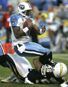 2008 Vince Young's 2007 season continued into the new year when the Titans made the playoffs. Young had a less-than-stellar performance in the wild-card game against the Chargers, throwing for just 138 yards and an interception in a 17-6 loss in San Diego. The Chargers registered three sacks against Young, including this one by linebacker Shawne Merriman. Photo: Lenny Ignelzi, AP