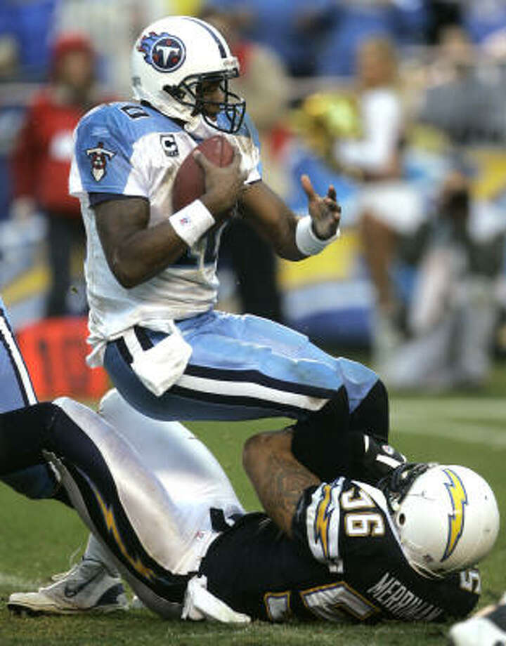 2008Vince Young's 2007 season continued into the new year when the Titans made the playoffs. Young had a less-than-stellar performance in the wild-card game against the Chargers, throwing for just 138 yards and an interception in a 17-6 loss in San Diego. The Chargers registered three sacks against Young, including this one by linebacker Shawne Merriman. Photo: Lenny Ignelzi, AP