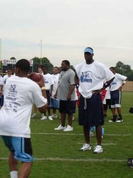 2008 Vince Young evaluates young football players at the first Vince Young Football Camp held at Butler Stadium. Photo: Joseph Duarte, Chronicle