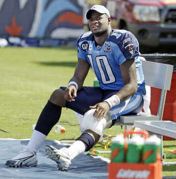 2008 Vince Young sits on the bench with ice on his knee after leaving the season-opener against the Jaguars in the fourth quarter. The Titans won 17-10, but it would be the last start Vince Young would make through Week 15. Photo: Mark Humphrey, AP
