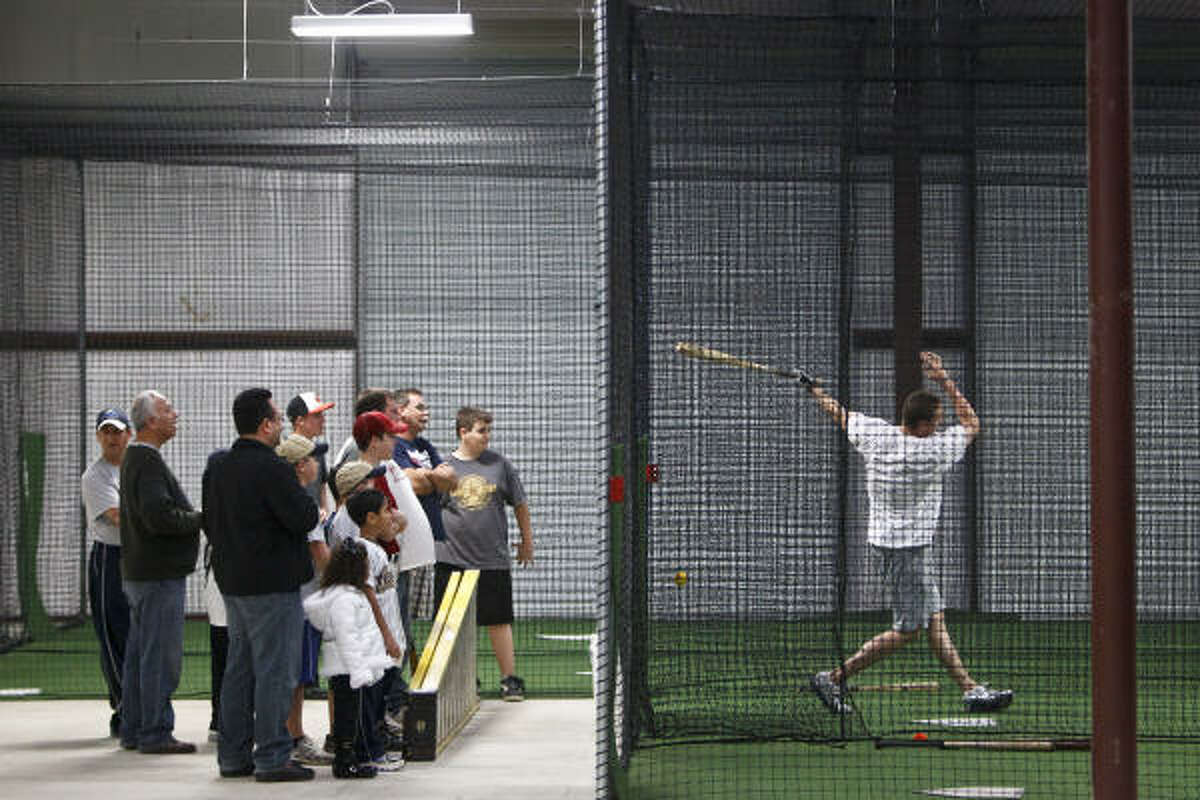 Hunter Pence takes batting practice while spectators watch.