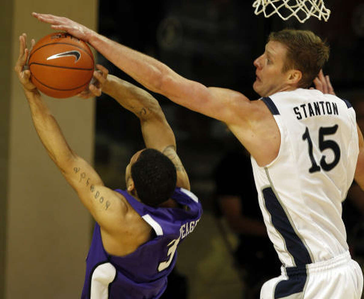 Rice's Trey Stanton, right, denies a shot by TCU's Sammy Yeager, left.