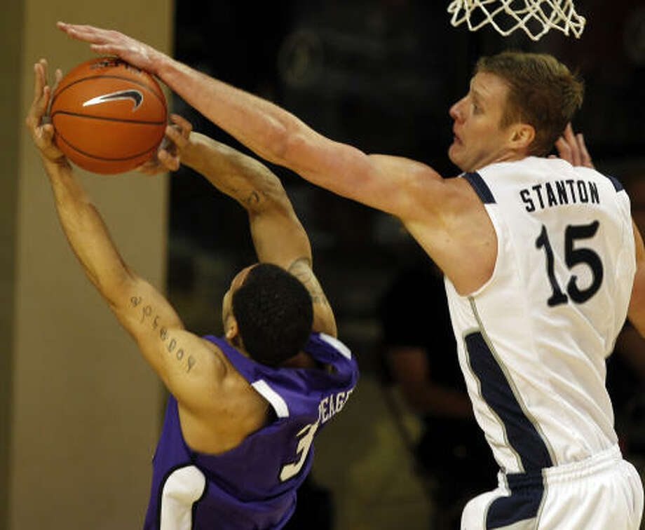 Rice's Trey Stanton, right, denies a shot by TCU's Sammy Yeager, left. Photo: Melissa Phillip, Chronicle