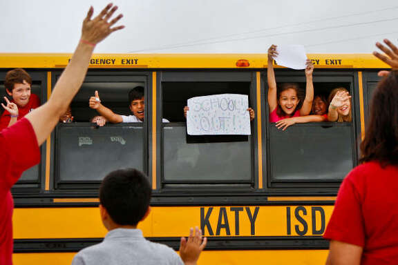 June 3, 2010   | Fourth-grade students, Rex Stamatis, 10, Brian Castro, 10, Kelly Escovy, 10, Hannah Watson, 10, and Sueda Ay, 10, wave to teacher Doris Ortiz, her son Ryan, 10, and teacher Joanna Everett while waiting for the school bus to depart after the last day of school at Stanley Elementary School in Katy.