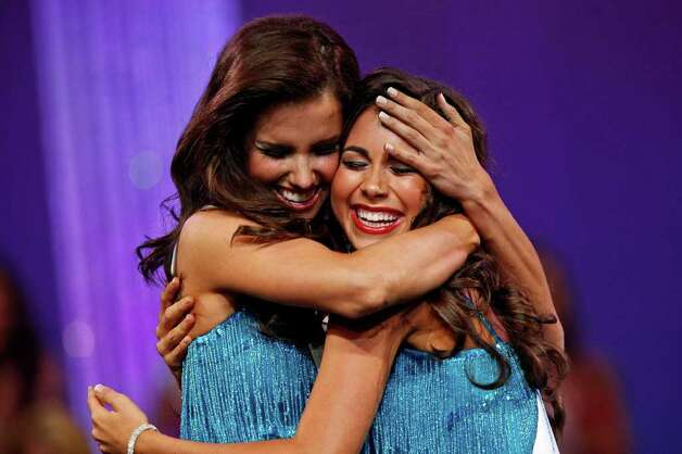 Miss Frisco Kendall Morris embraces Miss Austin Monique Evans as they find out they have made the Top 10 during the Miss Texas