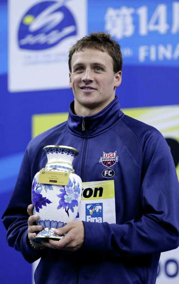 U.S. Ryan Lochte holds the trophy he won as best swimmer of the FINA 2011 Swimming World Championships in Shanghai, China, Sunday, July 31, 2011. (AP Photo/Michael Sohn) Photo: Michael Sohn