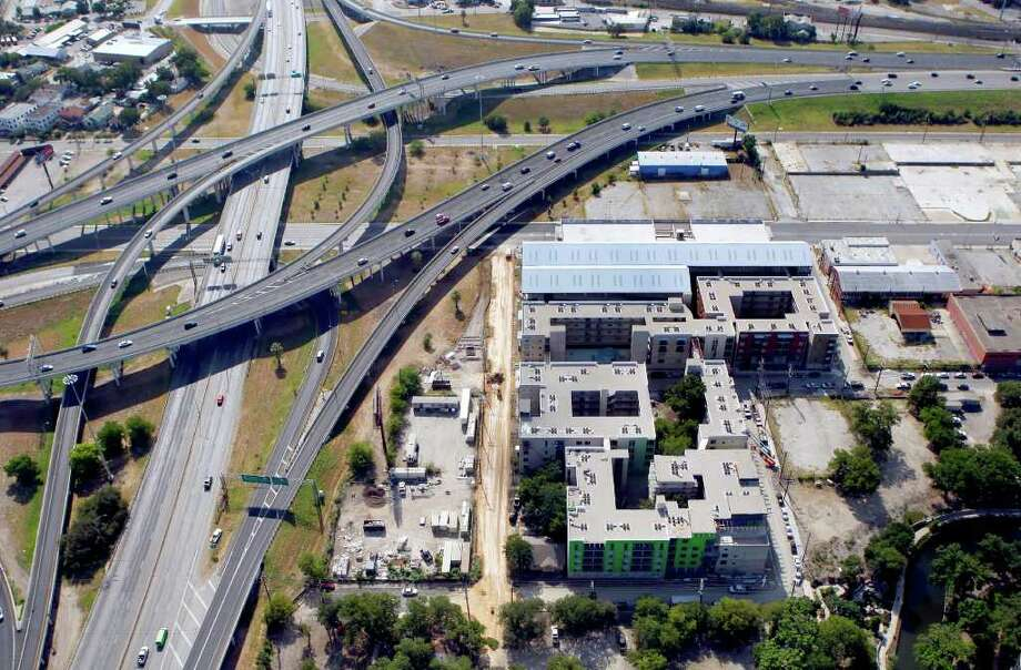 The 1221 Broadway Building is seen in this Friday July 29, 2011 aerial pictures. I-35 is seen at the left of the frame going top to bottom. US 281 is seen at the top of the frame going left to right. The 1221 Broadway won for best residentail in the Downtown Alliance's 12th annual Downtown's Best Awards. Photo: WILLIAM LUTHER, Express-News / 2011 SAN ANTONIO EXPRESS-NEWS