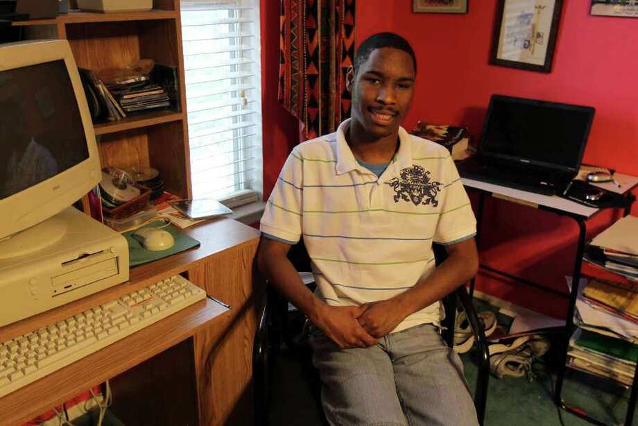 When he was born in 1992, Curtis Davenport Jr. was the smallest baby on record to survive in S.A. This May he graduated from Stevens High School and will go on to attend Northwest Vista College for creative writing, surprising all the doctors who said a baby his size would probably have disabilities. (Photographed at the family's home in San Antonio, July 1, 2011) Photo: Jennifer Whitney, Express-News / special to the Express-News