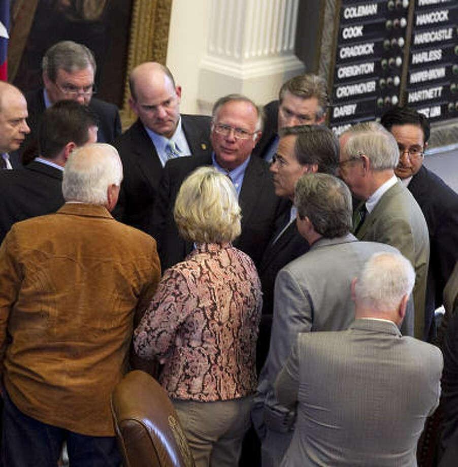 "Legislators gather around House Speaker Joe Straus on Saturday. Straus deflected critics, saying he thought ""everyone played within the rules."" Photo: Larry Kolvoord, Austin American-Statesman"