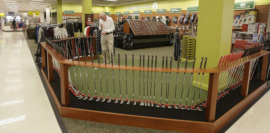 Big names in golfing goods surround employee Chuck Pack at the Edwin Watts Golf store inside the Sears at Deerbrook Mall. Photo: James Nielsen :, Chronicle