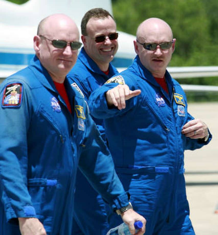 Mark Kelly, right, husband of Rep. Gabrielle Giffords, and his twin, Scott Photo: Terry Renna, Associated Press File