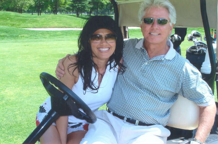 KHOU anchor Lucy Noland ends up playing many of her rounds of golf in charity tournaments, including one in New York in which she teamed up with Larry Strickland, right, the husband and manager of country singer Naomi Judd. Photo: Courtesy Of Lucy Noland