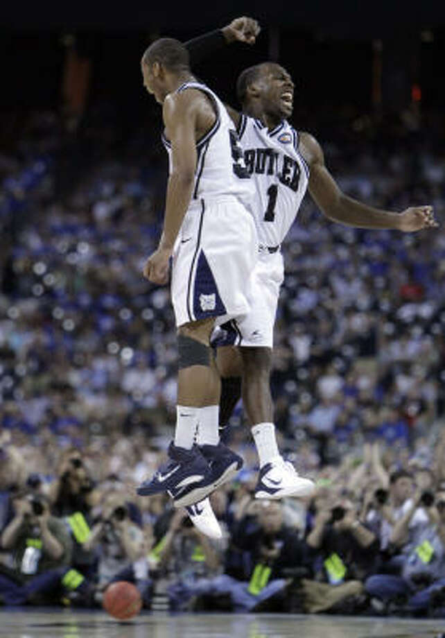 Butler guards Shelvin Mack (1) and Ronald Nored celebrate following Saturday's victory over VCU in the national semifinals at Reliant Stadium. Photo: Karen Warren, Chronicle