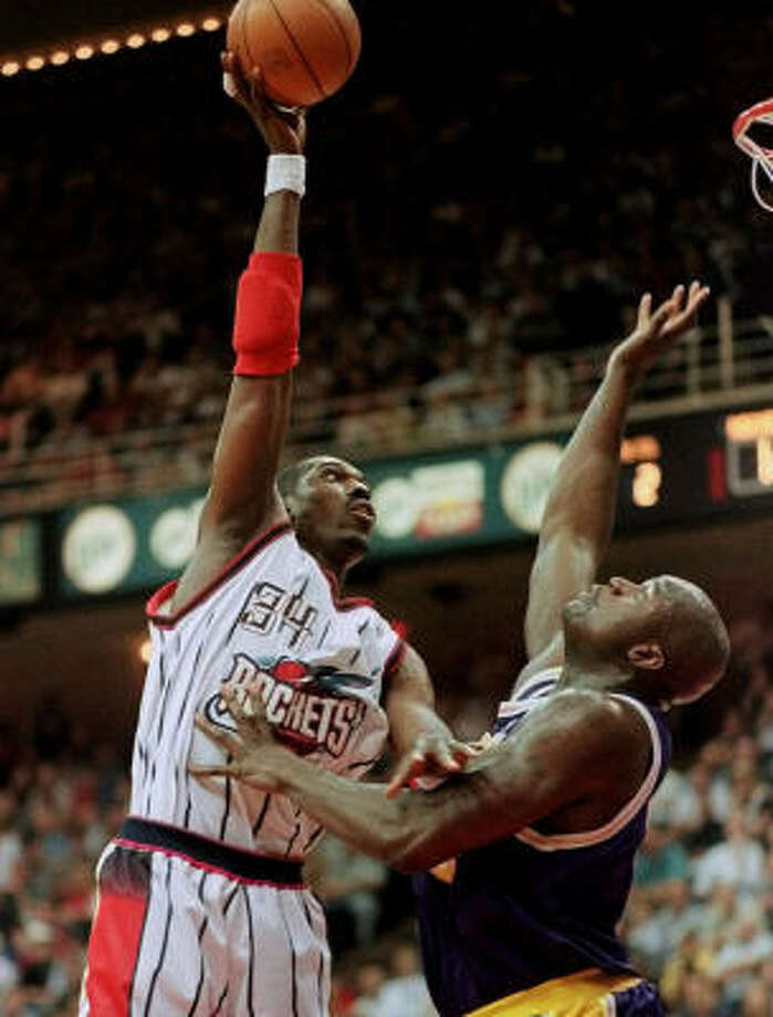 Hakeem Olajuwon and Shaquille O'Neal faced off several times during their Hall of Fame-caliber careers. Photo: AP