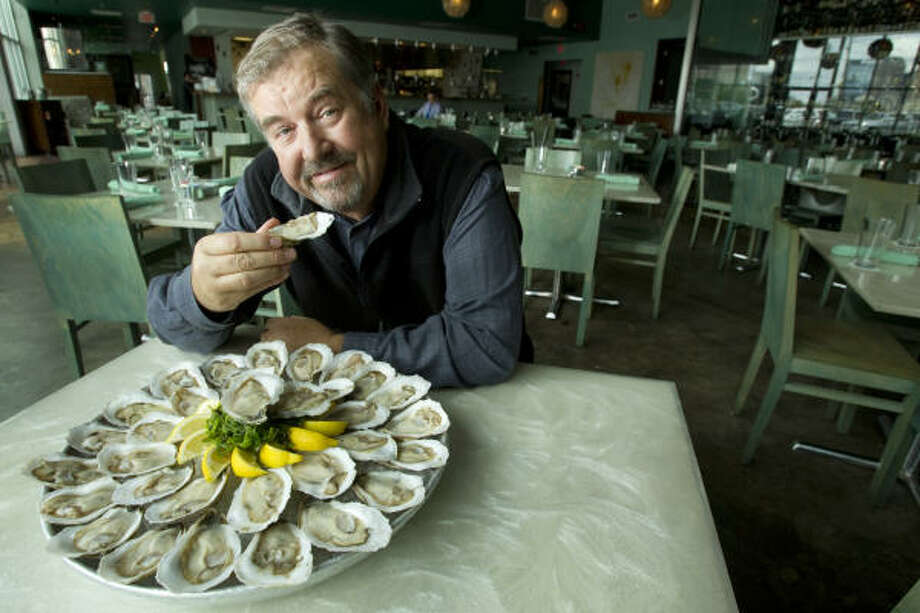 Robb Walsh, seen at Reef, is among local oyster fans who believe that one way to help market Gulf oysters is to name them after the geographical areas from which they're harvested. He's a founding member of Foodways Texas. Photo: Brett Coomer, Houston Chronicle