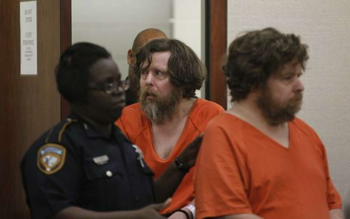 Edwin Berndt follows his brother, Edward, as they appear in 339th State District Court on Wednesday.