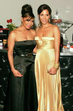 Singer Janet Jackson (L) and actress Halle Berry pose during the Ebony Pre-Oscar celebration at Jim Henson Studios on February 22, 2007 in Los Angeles, California. Photo: Frederick M. Brown, Getty Images / 2007 Getty Images