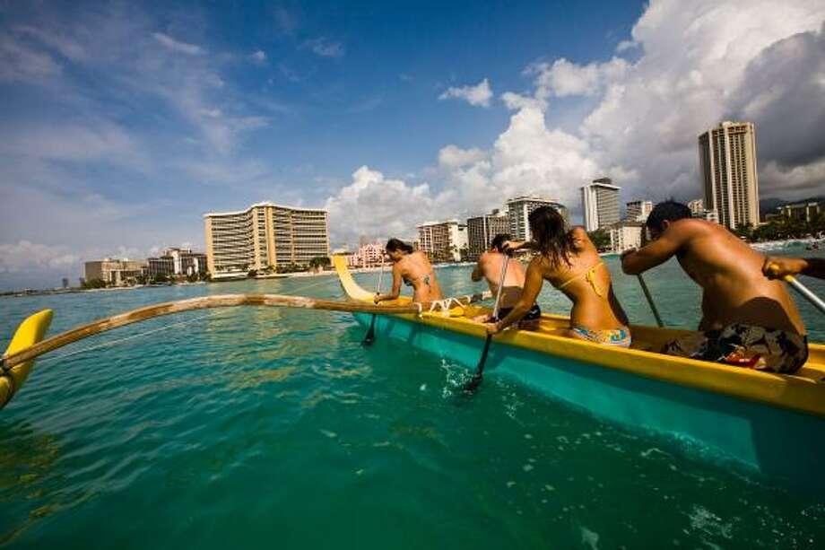 Paddling a canoe off Waikiki Beach in Oahu. Photo: Oahu Visitors Bureau