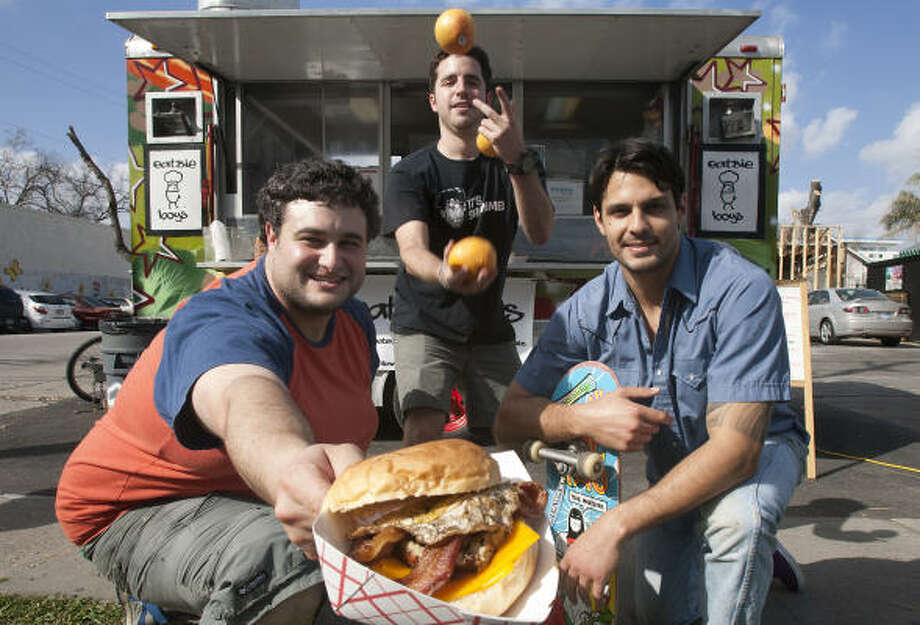 Matt Marcus, Ryan Soroka and Alex Vassilakidis  recently opened a food trailer, Eatsie Boys. Photo: Cody Duty, Houston Chronicle