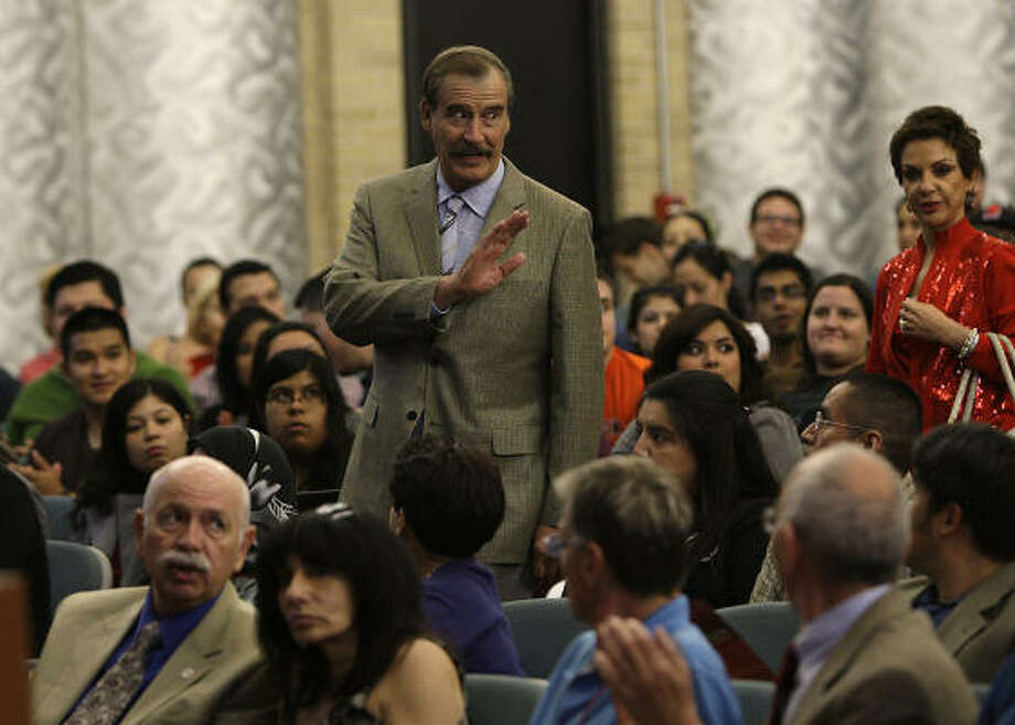 "Vicente Fox, a former president of Mexico, waves to the crowd as he and his wife, Marta Sahagun, arrive at a venue on the University of Houston where he was to deliver a speech on ""Leadership and Spirituality in America."" Photo: Karen Warren, Houston Chronicle"