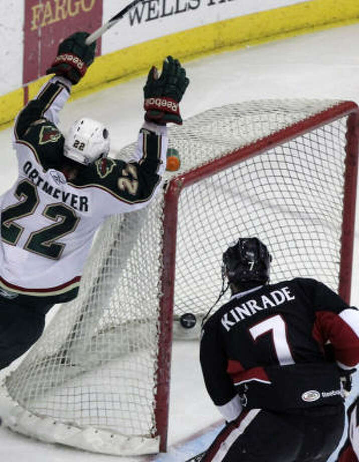Aeros right wing Jed Ortmeyer celebrates after scoring a goal as Binghamton Senators defenseman Geoff Kinrade looks on in the third period on Friday night. Photo: Cody Duty, Chronicle