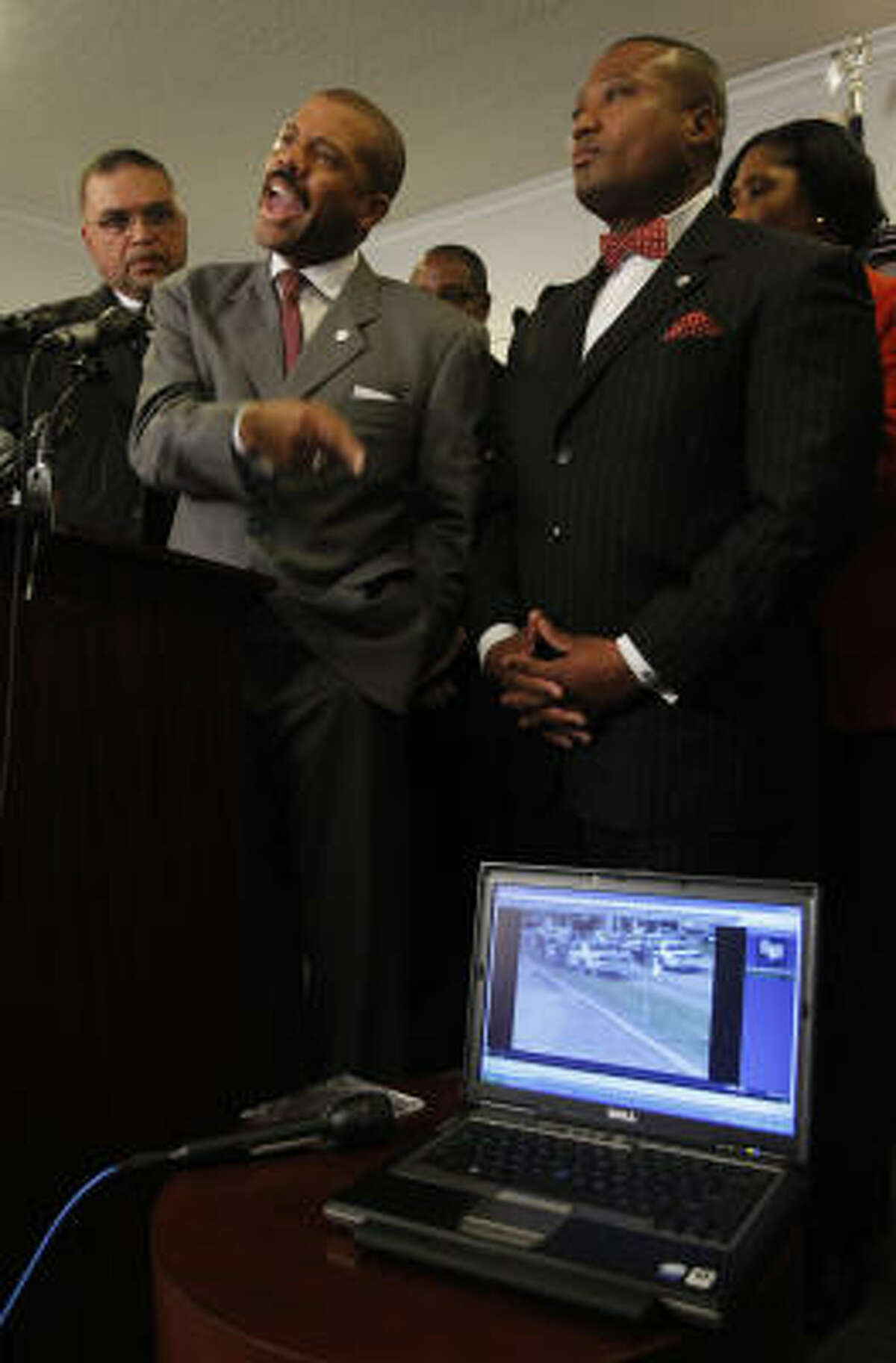 D.Z. Cofield, left, president of the NAACP Houston Branch, State Rep. Borris Miles and Quanell X say they were shocked by the actions depicted on the videotape.