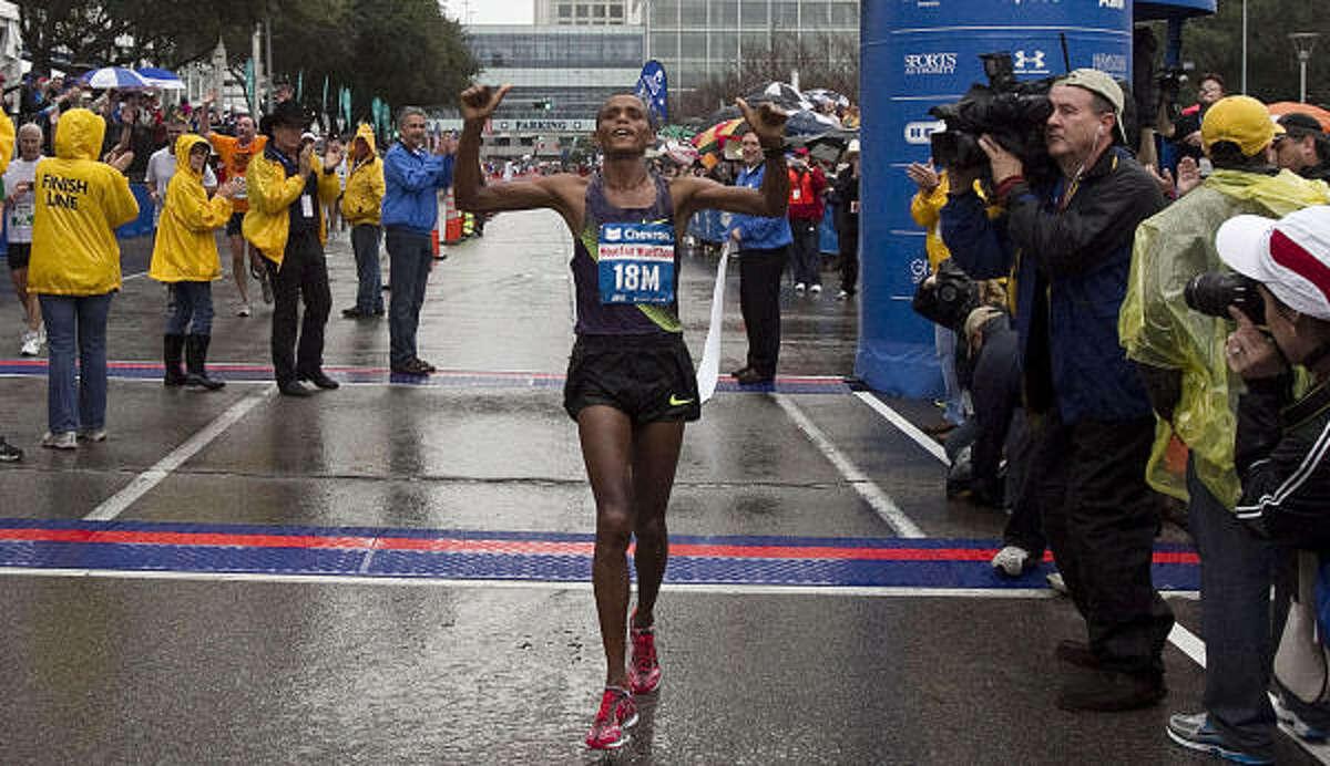 Bekana Daba crosses the finish line to win the men's division of the Chevron Houston Marathon.