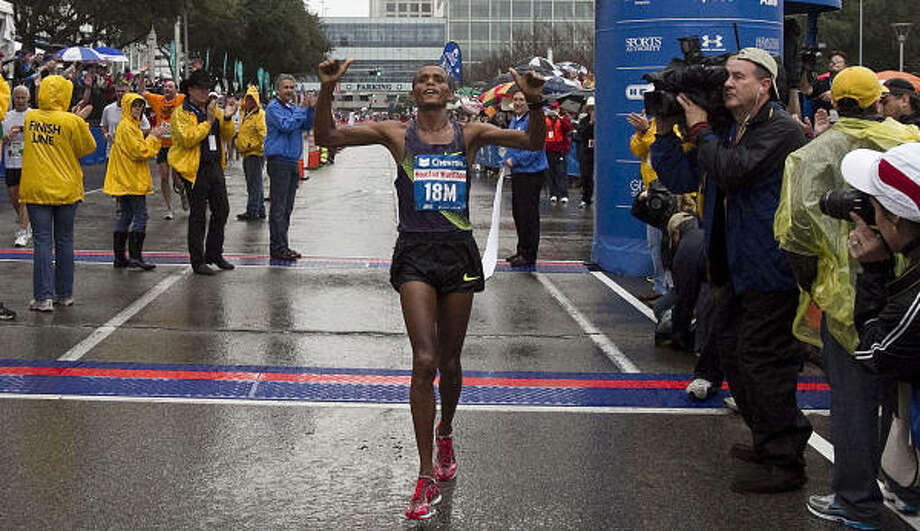 Bekana Daba crosses the finish line to win the men's division of the Chevron Houston Marathon. Photo: James Nielsen, Chronicle