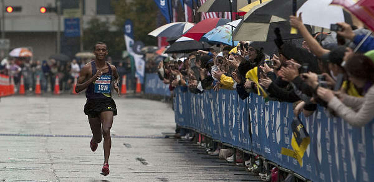 Bekana Daba approaches the finish line as he sets a record for the Houston Marathon.