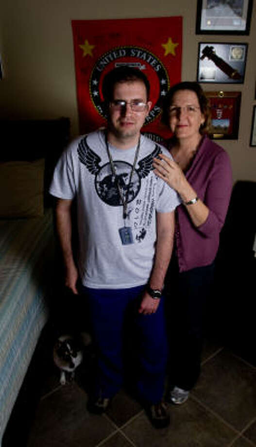U.S. Marine veteran Steven Schulz, 26, shown with his mother, Debbie, at their Friendswood home, suffered traumatic brain injury in 2005 while serving in the Iraq War. Photo: Billy Smith II, Chronicle