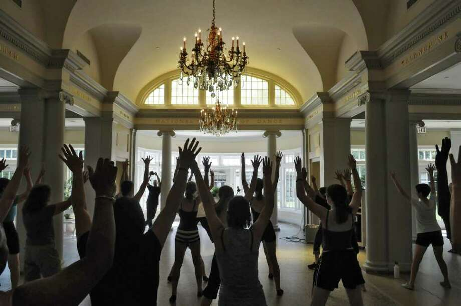 Dancers participate in an aerobic dance demonstration during the National Dance Day at the National Museum of Dance on Sunday July 31, 2011 in Saratoga Springs, NY.  ( Philip Kamrass / Times Union) Photo: Philip Kamrass