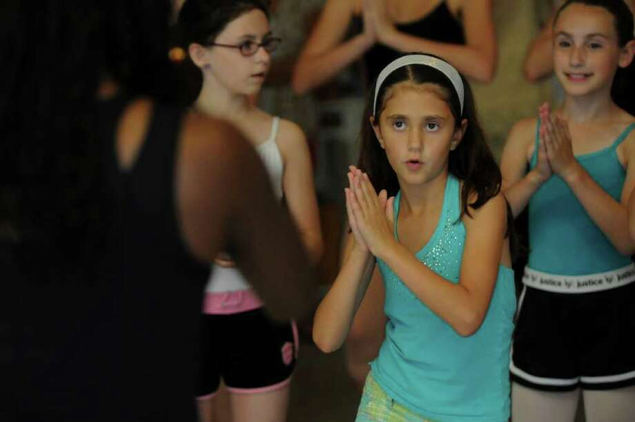 Sophia Pearlman of Albany, 9, participate in dance fitness demonstration by Yonka Perkins of the Saratoga Regional YMCA, left, during the National Dance Day at the National Museum of Dance on Sunday July 31, 2011 in Saratoga Springs, NY.  ( Philip Kamrass / Times Union) Photo: Philip Kamrass