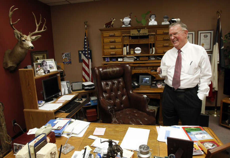 Bill Bailey looks happy with his decision Tuesday in his Pasadena office after announcing he would resign as Precinct 8 constable effective May 31. Bailey, 72, was first elected in 1982. Photo: Melissa Phillip, Houston Chronicle