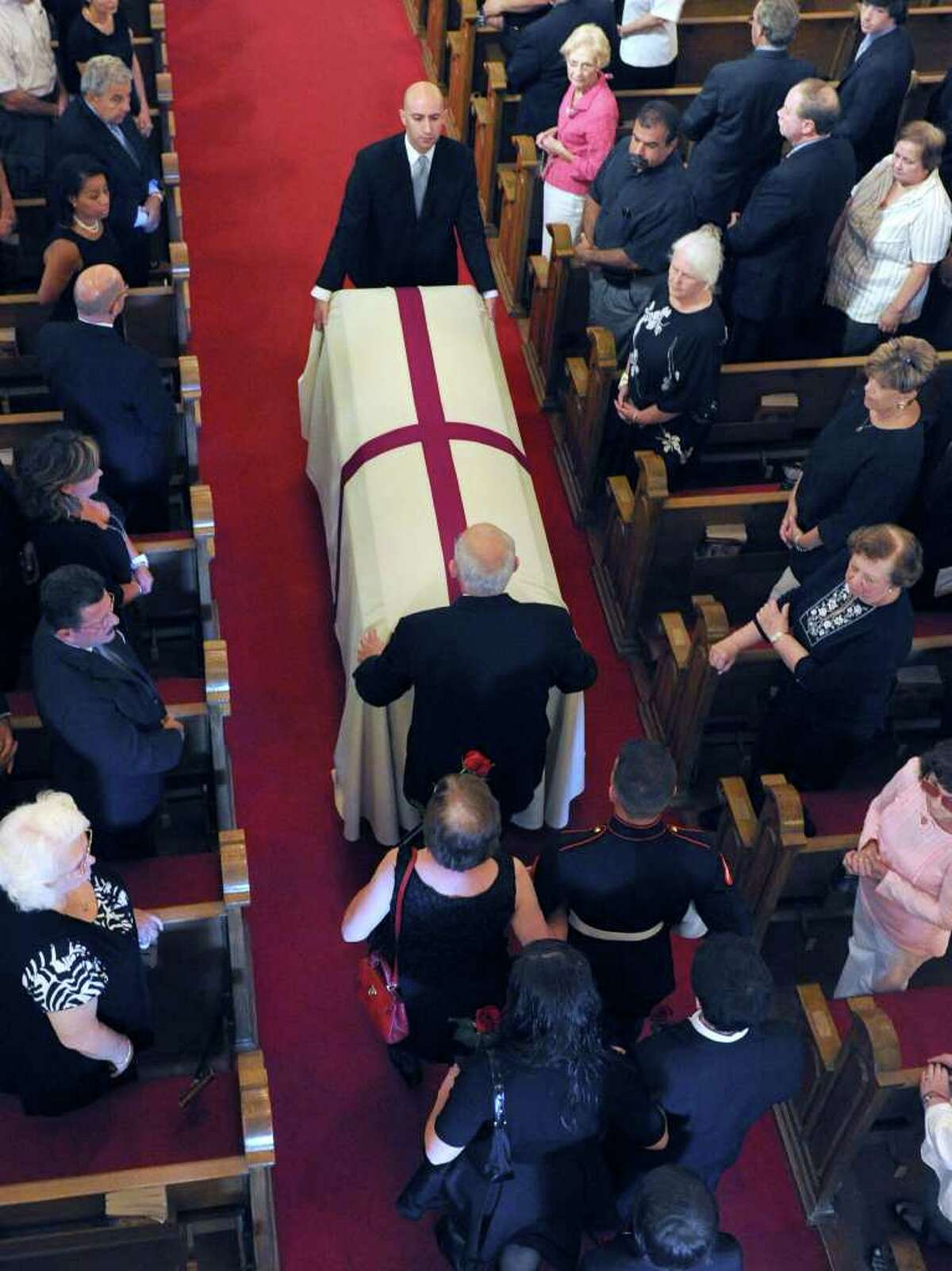 The coffin bearing the body of former Danbury Mayor James E. Dyer is brought into St. Joseph Church in Danbury Monday morning, Aug. 1, 2011.