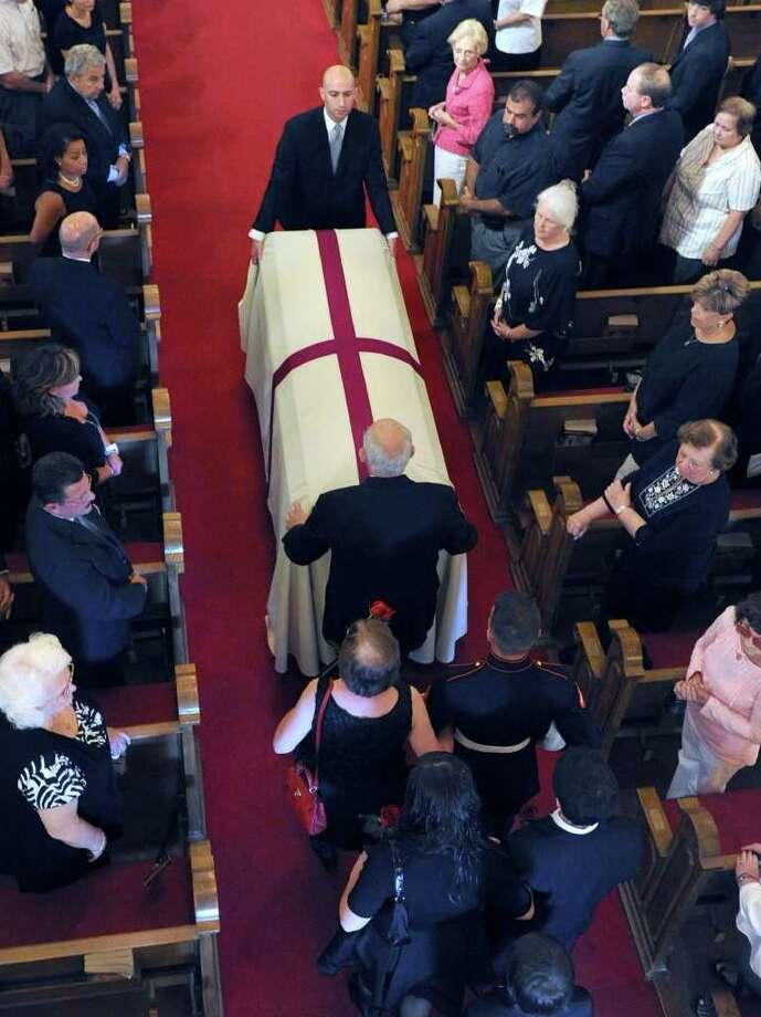 The coffin bearing the body of former Danbury Mayor James E. Dyer is brought into St. Joseph Church in Danbury Monday morning, Aug. 1, 2011. Photo: Carol Kaliff