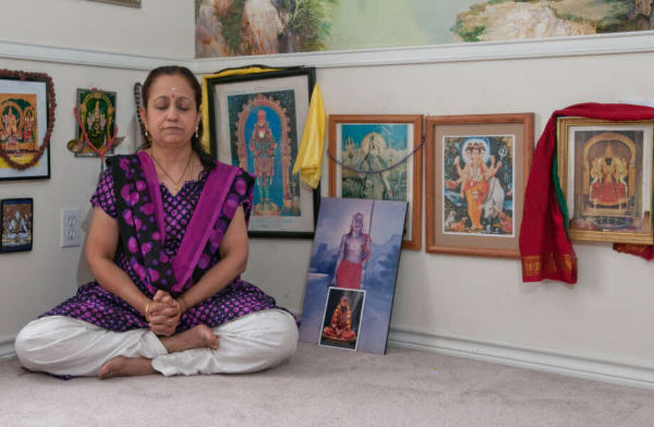 Dr. Sudha Rajan is the president of a nonprofit research organization that specializes in yoga therapy.  As a Hindu, she says she feels a deeper connection with the practice and is able to get physical, mental and spiritural benefits from it. Photo: Kim Christensen