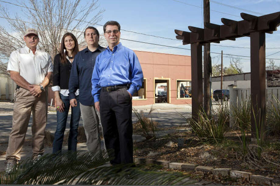 From left, Steve Christian of Christian's Tailgate Bar & Grill, who will open his third location; Sharon Haynes of Tacos A Go-Go, who will open her second location; area developer Bryan Danna; and Nash D'Amico, who will open his second D'Amico's restaurant, are coming to White Oak in the Heights. Photo: Todd Spoth:, For The Chronicle